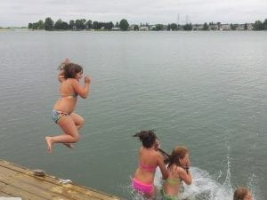 Swimming off of our dock.
